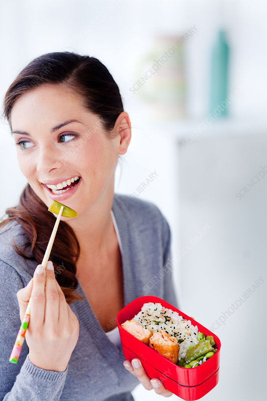 Woman eating bento