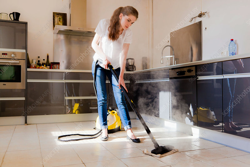Woman using a steam cleaner