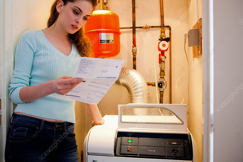 Woman checking her boiler