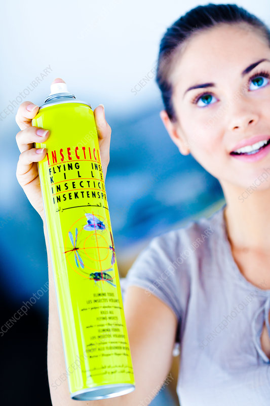 Woman using an insecticide