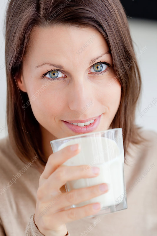 Woman drinking soy milk