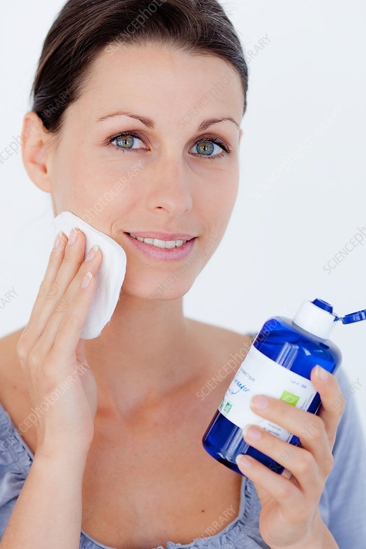 Woman using water lotion