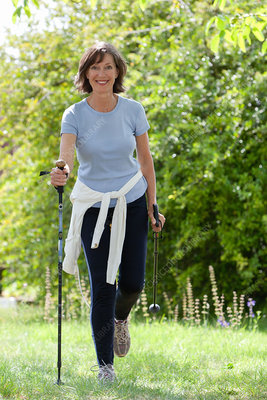 Woman practicing nordic walking