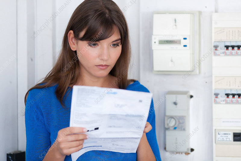Woman reading electricity meter