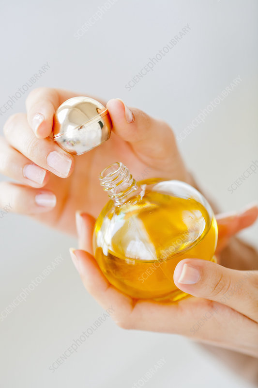 Woman using cosmetic oil