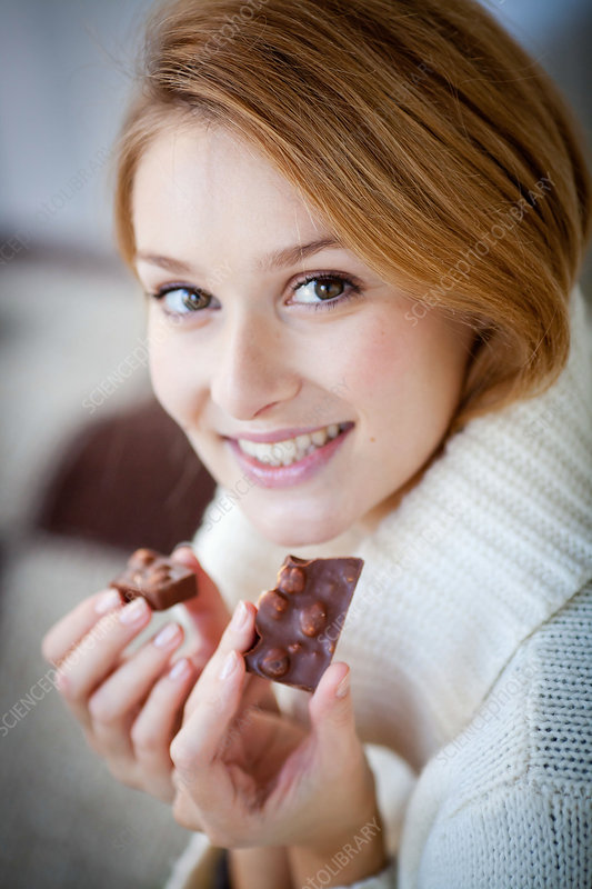 Woman eating hazelnut chocolate