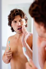 Man brushing his teeth