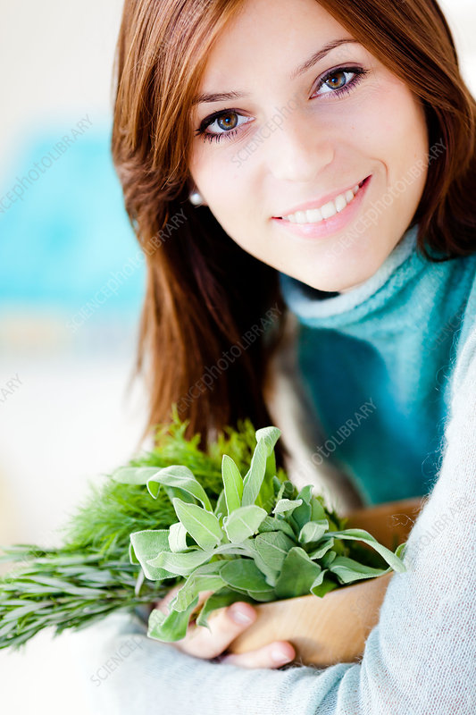Woman holding herbs