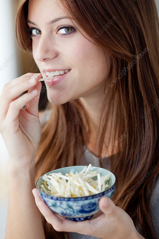Woman eating soybean sprouts