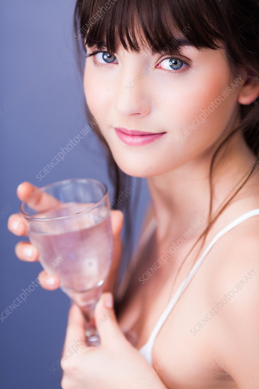 Woman drinking mineral gas water