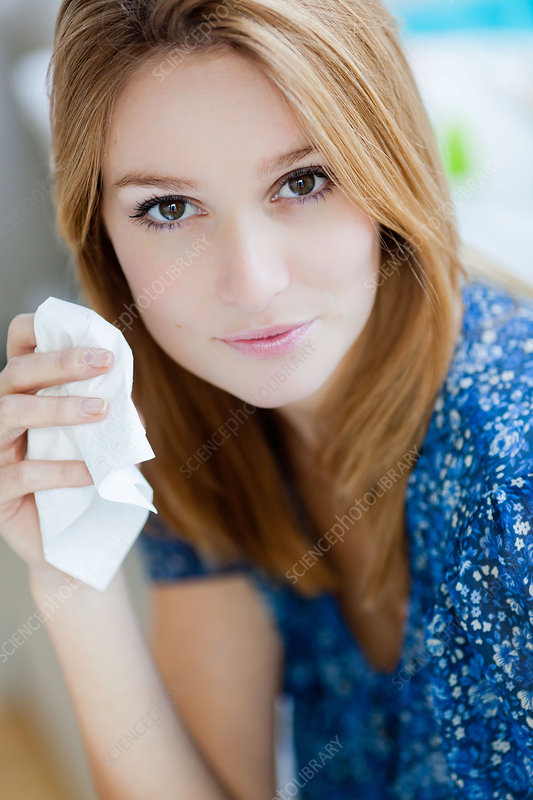 Woman suffering from rhinitis