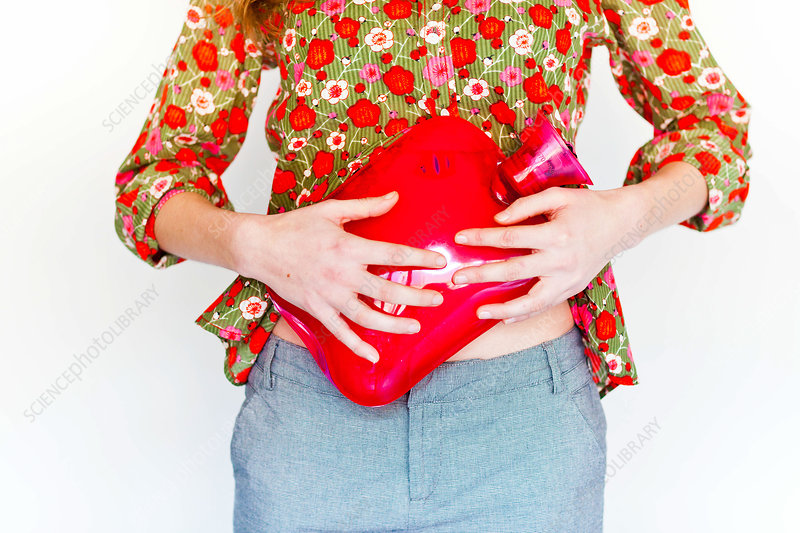 Woman using a hot-water bottle
