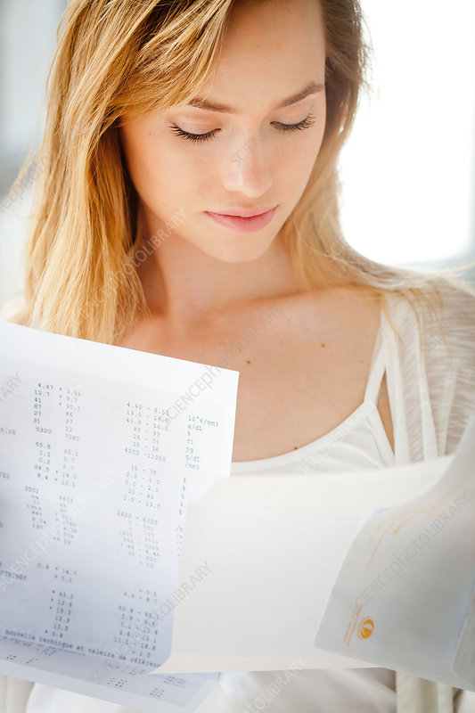 Woman reading medical analysis results