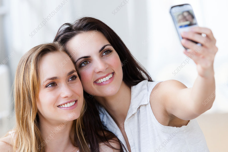 Young women taking photo