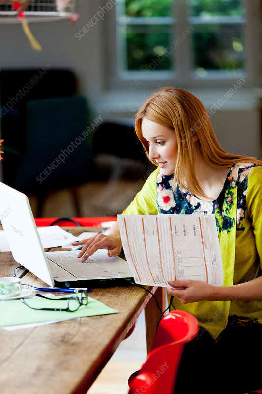 Woman checking medical expenses