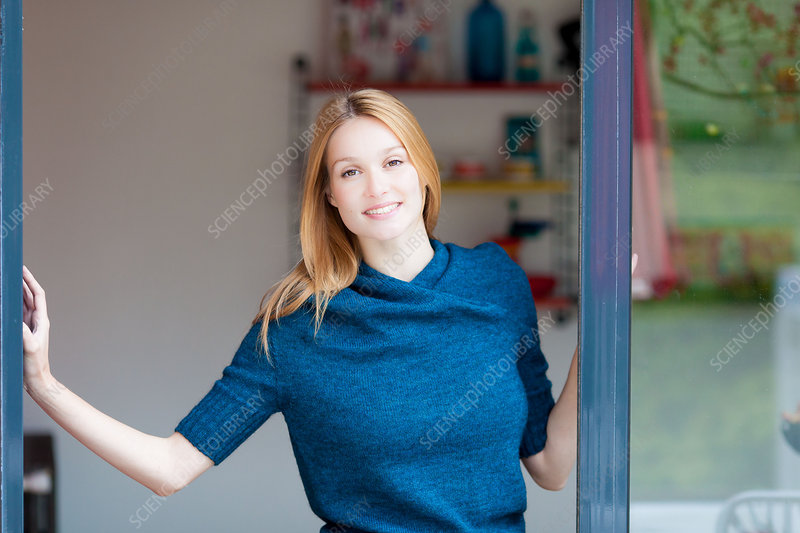 Woman opening French window