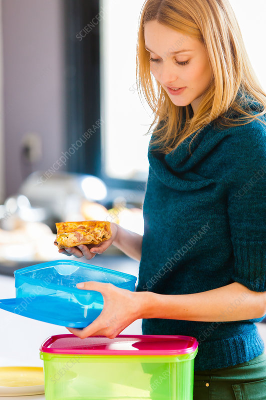 Woman using plastic boxes for food