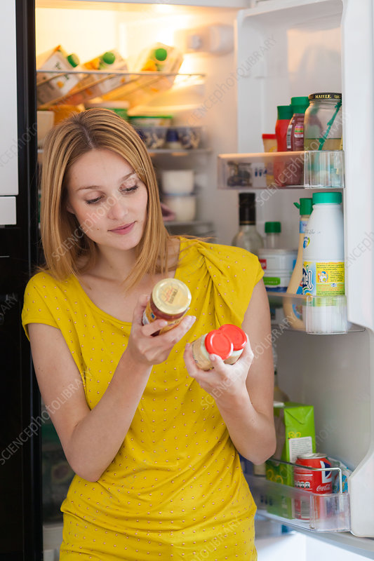 Woman checking nutrition facts