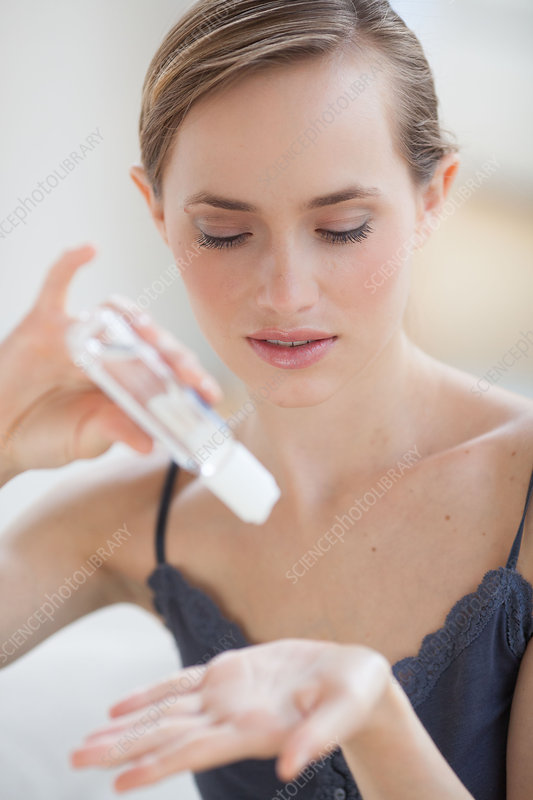 Woman using hydroalcoholic gel