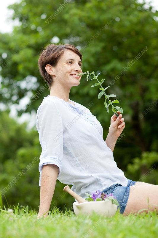 Woman picking plants
