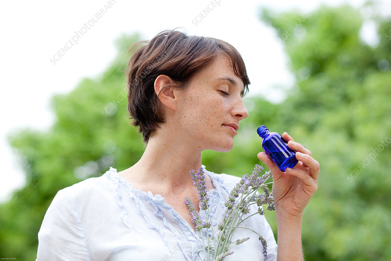 Woman inhaling the scent of lavender