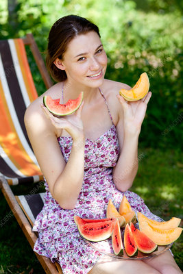 Woman eating watermelon and melon