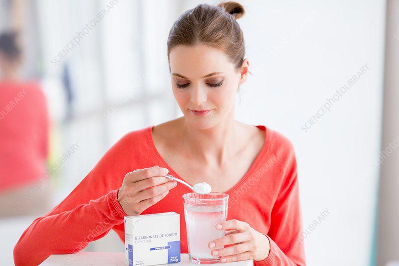 Woman taking sodium bicarbonate