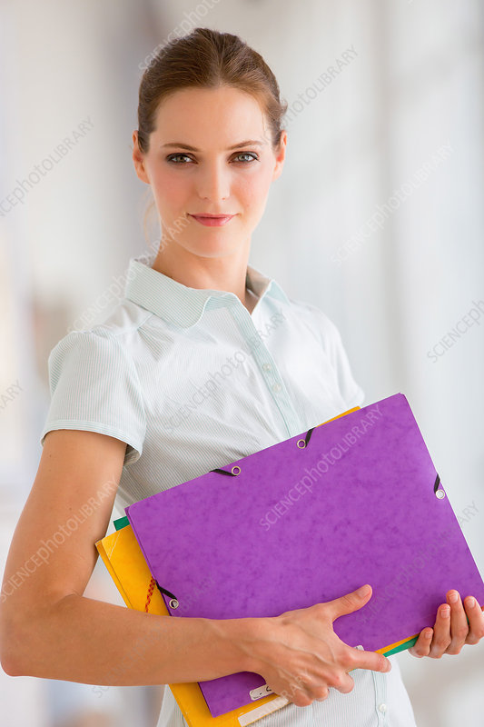 Woman holding some folders