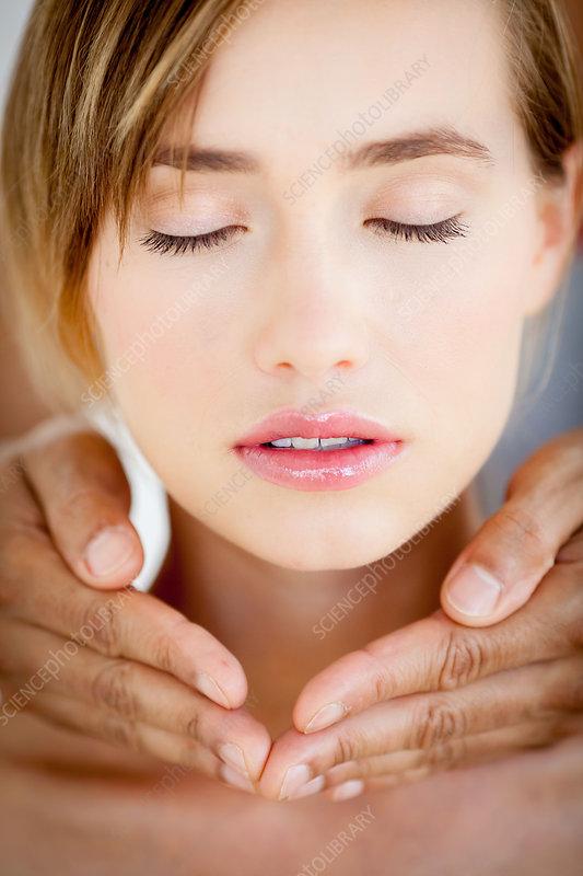 Woman receiving reiki treatment