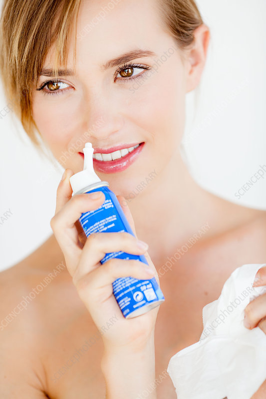 Woman using a sterile sea water spray