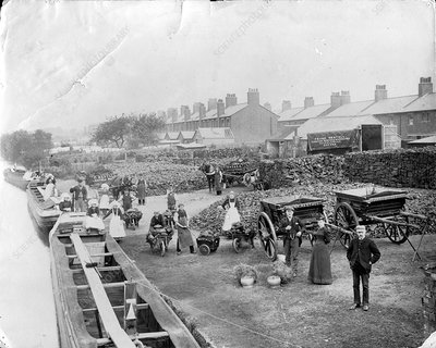 Unloading coal barges, 1890s