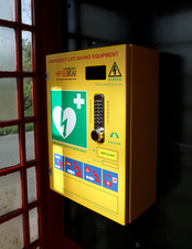 Community defibrillator in red telephone kiosk