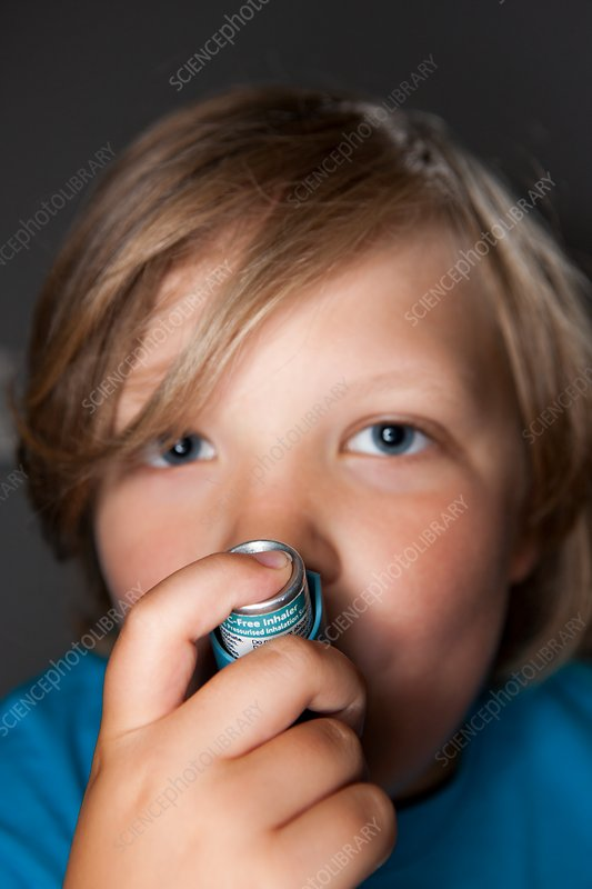 Child using asthma inhaler