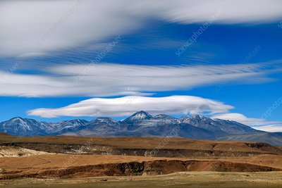 Lenticular clouds over Andean volcanoes