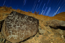 Atacama rock art and star trails, time-exposure image