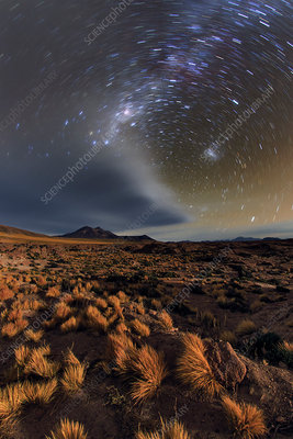 Clouds and star trails over the Atacama Desert