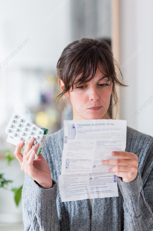 Woman with medicine instruction sheet