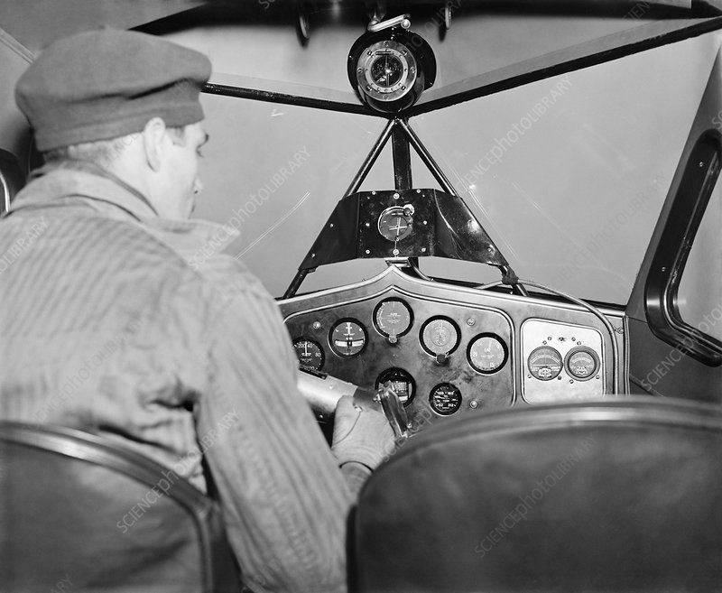 Pilot in cockpit with instrument landing system, 1937