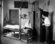 X-ray machine in use, early 20th century