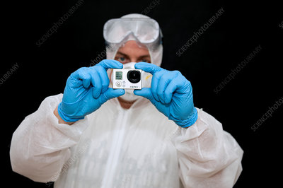 Photographer in protective clothing