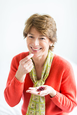 Woman eating cranberries