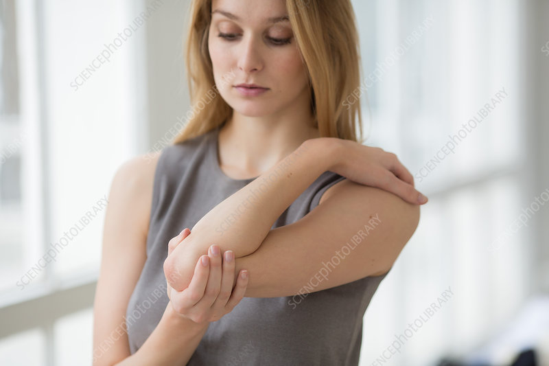 Woman suffering from pain in the elbow