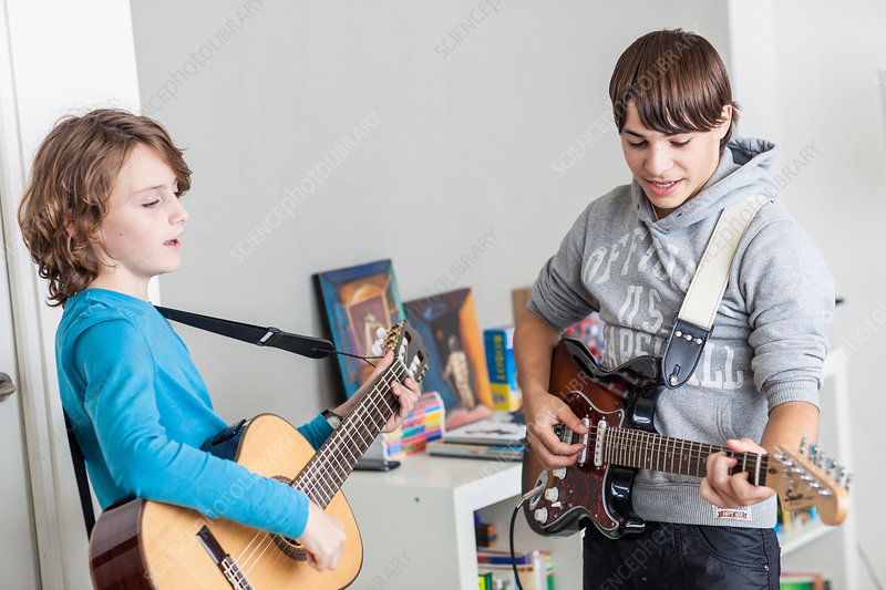 Teenager playing guitar