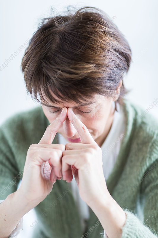 Senior woman suffering from sinusitis