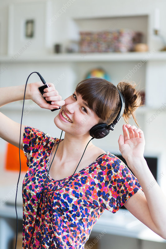 Woman listening to music on an ipod MP3 player