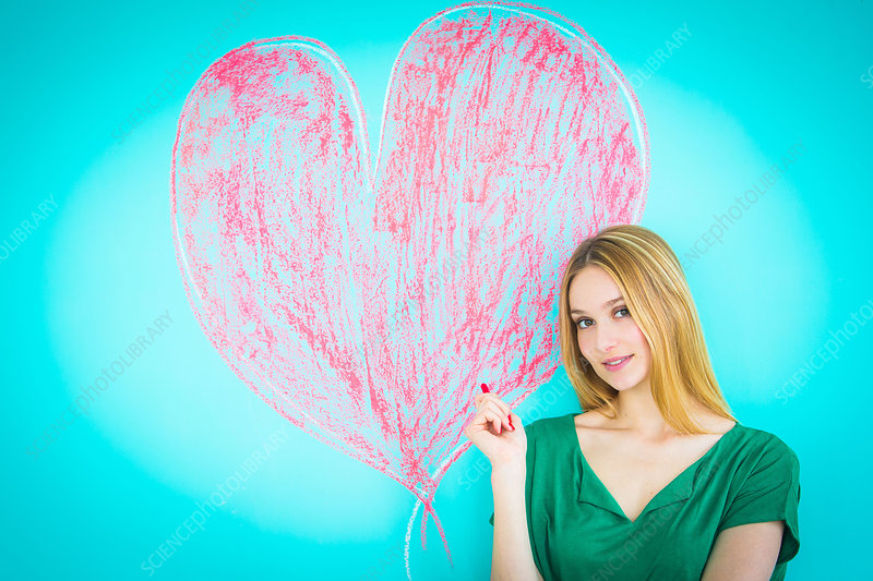 Woman drawing heart