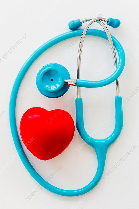 Stethoscope surrounding plastic heart