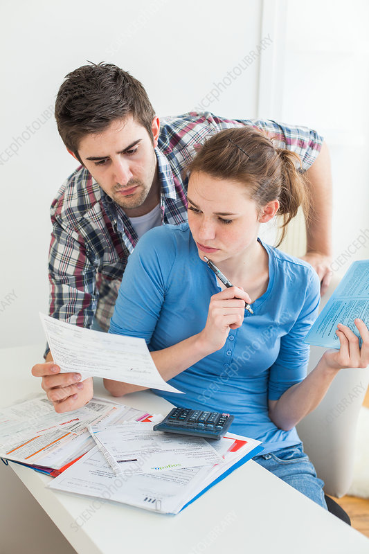 Young couple doing paperwork together