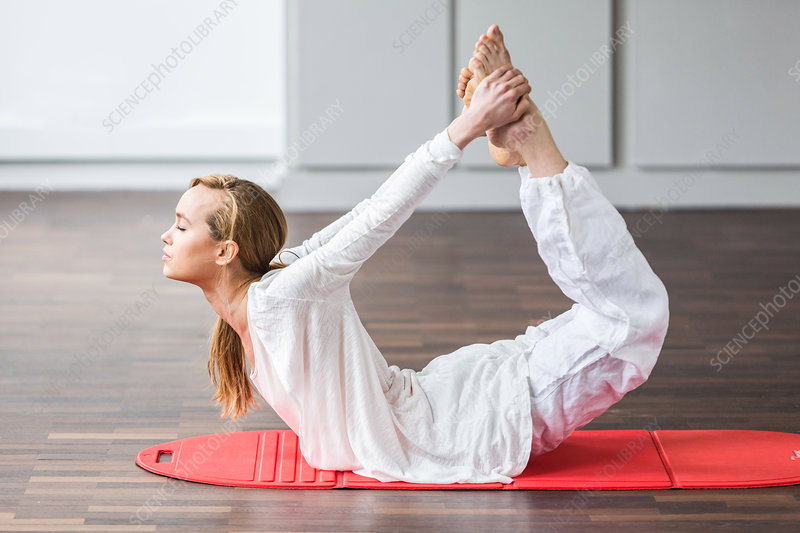 Woman practicing stretching exercises