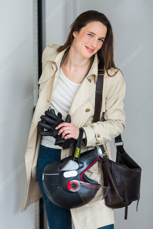 Woman holding motorcycle helmet